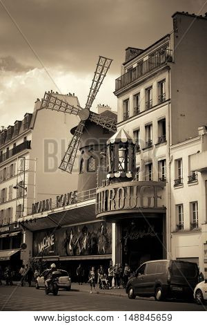 PARIS, FRANCE - MAY 13: Moulin Rouge and street view on May 13, 2015 in Paris. It is the most-visited paid monument in the world with annual 250M visitors.