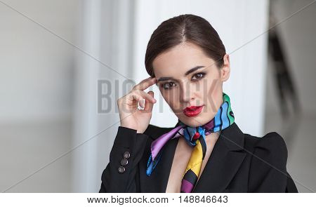close up portrait of young smart business woman thinking in blurred interior
