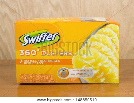 RIVER FALLS,WISCONSIN-SEPTEMBER 25,2016: A box of Swiffer brand dusting pads with a wood background.