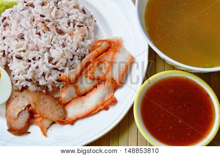 barbecued red pork in sauce with brown rice and soup