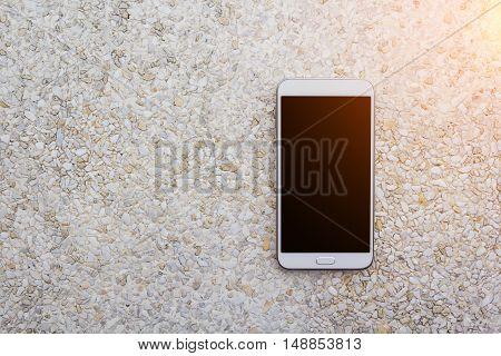Moblie smart phone on stone table background