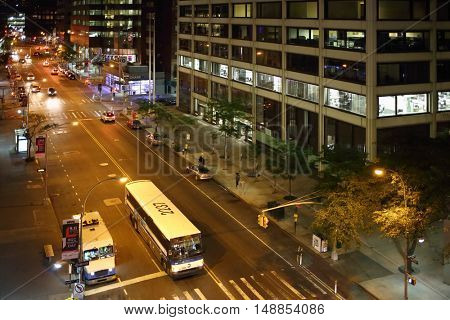 NEW YORK, USA - SEP 07, 2014: Water Street near the building One Wall Street Plaza in the evening, top view