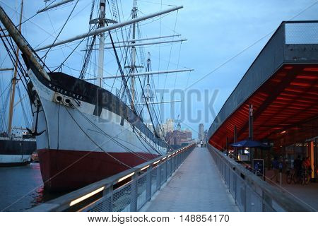 NEW YORK, USA - SEP 07, 2014: Historic ship Wavertree on the pier in the South Street Seaport in the evening