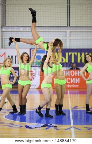 MYTISHCHI, RUSSIA - OCT 16, 2014: Girls (with model release) in light green costumes raised their girlfriend in the Championship of Russia on mini-football in Sports Complex Construction in Mytishchi