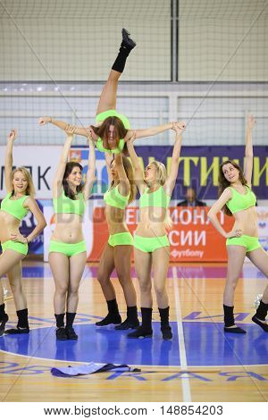 MYTISHCHI, RUSSIA - OCT 16, 2014: Six girls (with model release) in light green costumes dancing in the Championship of Russia on mini-football in the Sports Complex Construction in Mytishchi