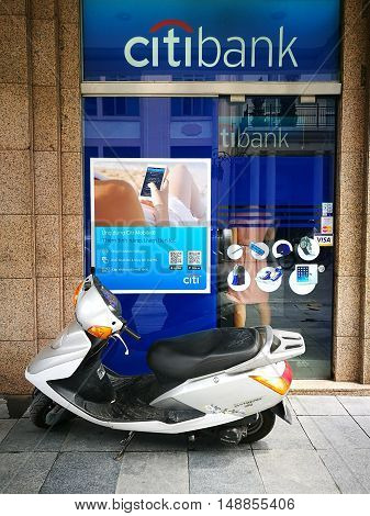 Hanoi, Vietnam - Sep 25, 2016: Asian customer making a transaction of withdrawing cash from an automatic teller machine (ATM) of Citibank in Hanoi capital. Citibank was founded in 1812 in New York.