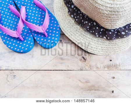 Blue flip flop with weaved hat for summer vacation background