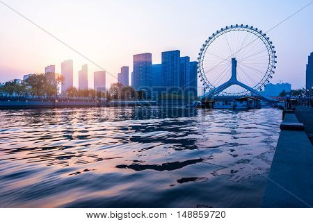 Tianjin Eye is a 120-metre (394 ft) tall giant Ferris wheel built above the Yongle Bridge (formerly Chihai Bridge), over the Hai River in Tianjin, China.