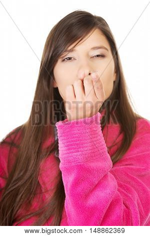 Woman holding contact lens.