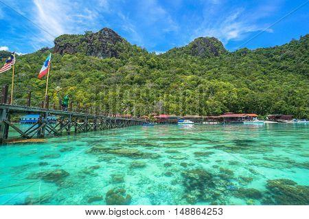 Semporna,Sabah-Sep 10,2016:Wooden jetty with Sabah & Malaysia flag at Bohey Dulang tropical island,Semporna,Sabah.Bohey Dulang Island is one of the most popular islands in Tun Sakaran Marine Park.