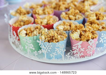 Homemade caramel popcorn in rainbow cupcake cups