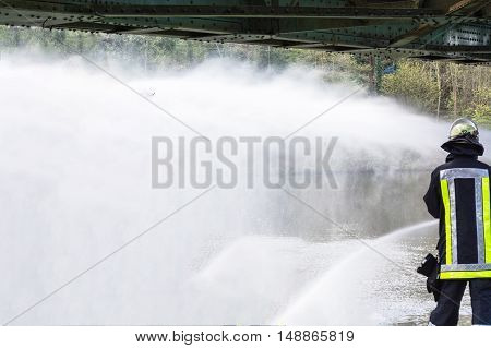 Fire department sprayed extinguishing water from fire hoses during an exercise.