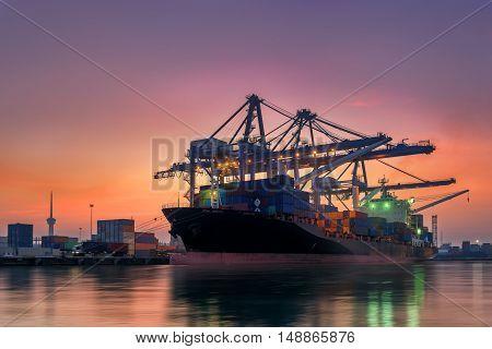 Cargo ship terminal at twilight scene Unloading crane of cargo ship terminal Sunrise shot.
