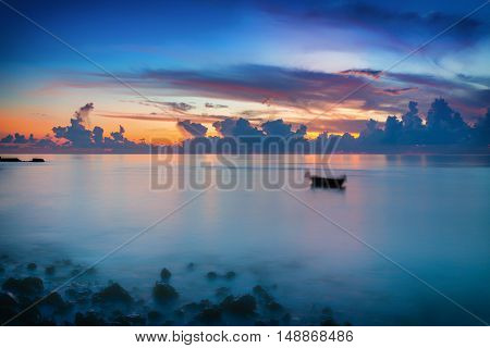 Calm sunrise over ocean on Maldives