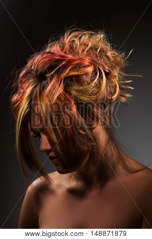 Portrait of a beautiful girl with dyed messy hair professional hair colouring