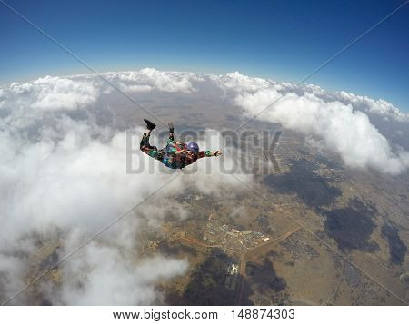 Skydiver in action with clouds in the background