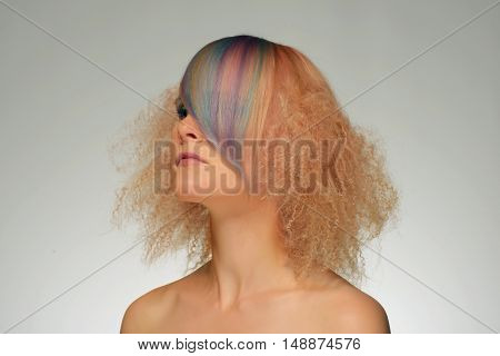 Portrait of a beautiful woman with multi coloured strand in hair professional hair colouring