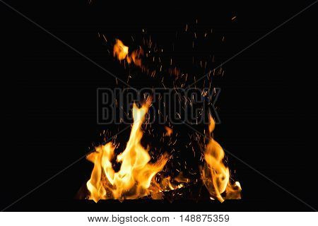 Photo fire with sparks close-up on a black background