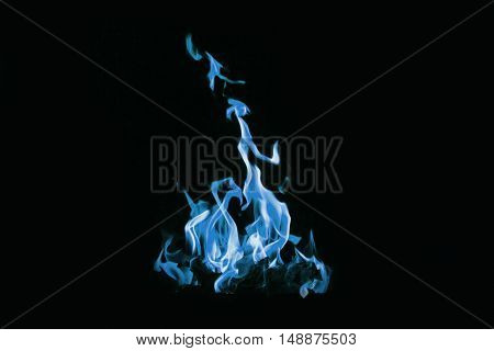 Photo blue fire with sparks close-up on a black background