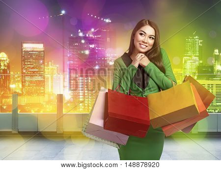Young Happy Asian Woman With Shopping Bags