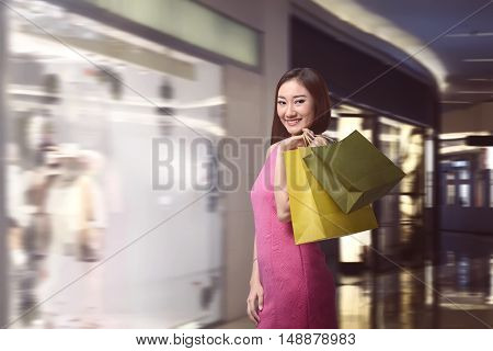 Happy Asian Woman With Paper Bags Doing Shopping