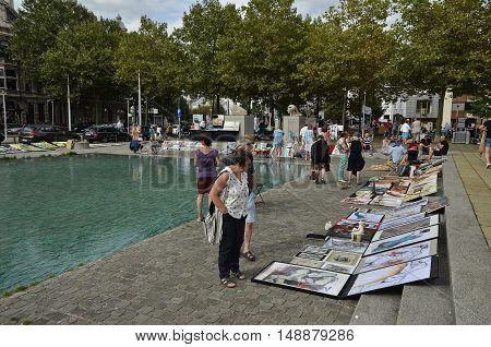 Antwerp Belgium - August 28 2016: Visitors at the weekend art market on the Leopold de Waelplaats on a summer afternoon