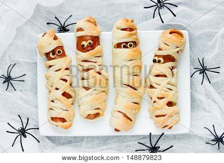 Funny idea for kids for Halloween food - sausage in dough as a mummy top view