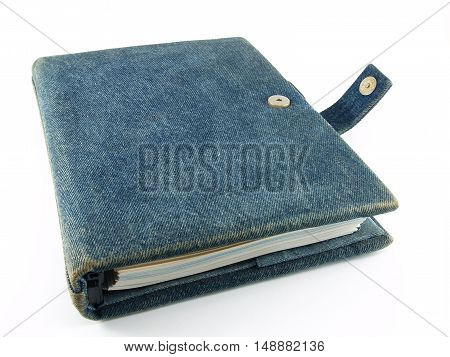 close up closed notebook diary isolated on white background, handmade book with denim cover