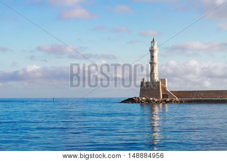 bay of Chania with waters of Aegan sea and lighthouse at sunny summer morning, Crete, Greece