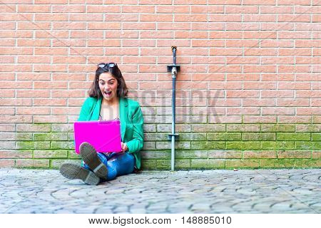 Young Student Beautiful Girl Sitting On The Ground Chat On Social Networks