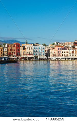 waterfront of Chania bay reflecting in water at sunny day, Crete, Greece