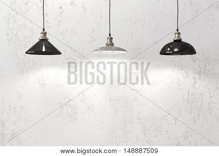 Industrial pendant lamps against rough wall, loft style