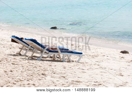 Chairs on a beautiful beach in thailsnd