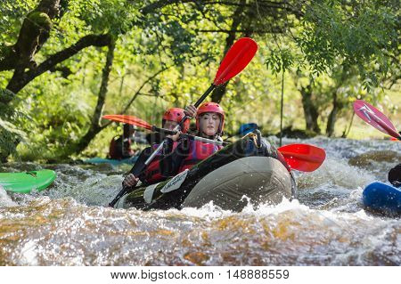 BALA WALES UNITED KINGDOM SEPTEMBER 17 2016: White water kayakers at the National White Water Centre canoeing through rapids on the River Tryweryn