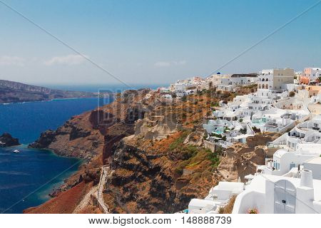 Oia, traditional greek village and Aegan sea waters, Santorini island, Greece