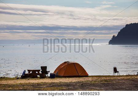 tent in waterfront camping in the Alaska. Summer season. Inspiring recreation.