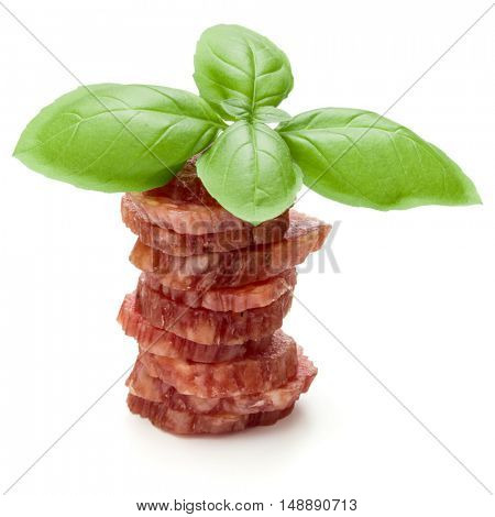 Salami smoked sausage slices and basil leaves isolated on white background cutout