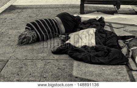 September 16th,2016 Los Angeles,California. Sad senior Man sleeping on the street in Downtown Los Angeles.