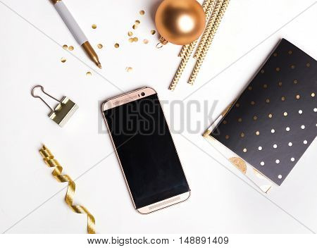 Golden Decor And Phone With Empty Screen