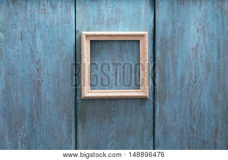 wooden photo frame on old blue wooden wall