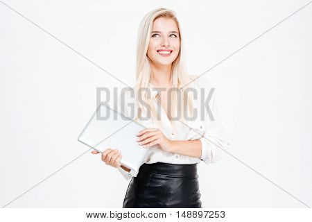 Smiling asian businesswoman holding tablet computer isolated on a white background