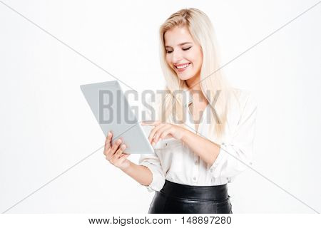 Beautiful happy businesswoman using tablet computer isolated on a white background