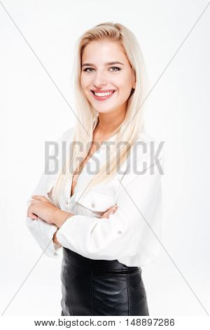 Happy pretty young businesswoman standing with arms crossed over white background
