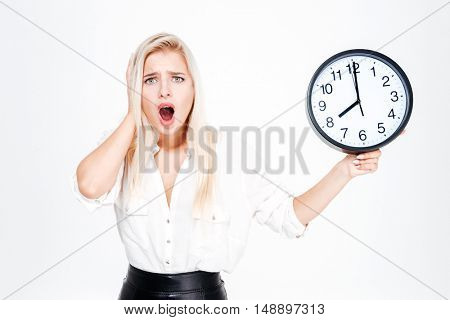 Surprised blonde businesswoman clock isolated on a white background