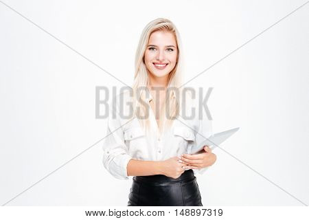 Smiling businesswoman holding tablet computer isolated on a white background