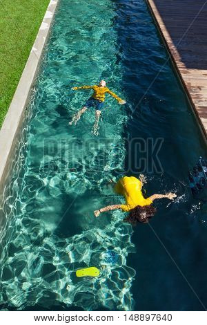 two children in the pool, outdoors