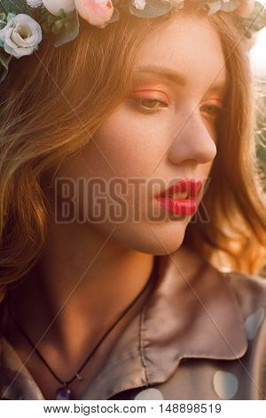 Beautiful girl in wreath seme profile photo. Portrait of fashion model with freckles looking down. Beauty, makeup, youth concept