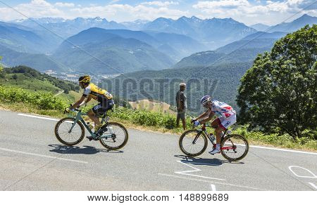 Col D'AspinFrance- July 152015: The cyclists Tom Leezer of Lotto NL-Jumbo Team and Sebastien Chavanel of FDJ Team climbing the road to Col D'Aspin in Pyrenees Mountains during the stage 11 of Le Tour de France 2015.