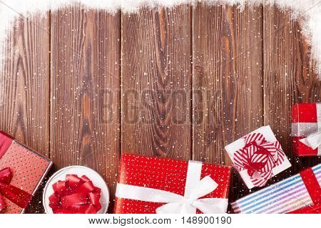 Gift boxes on wooden table. Top view with copy space