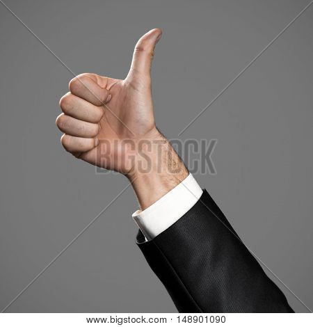 Business Man's Thumb Up Hand Sign.
